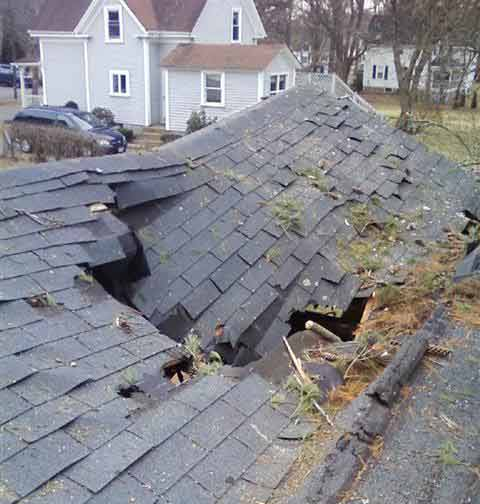 Heritage Roofing worker repairing composition tile roof