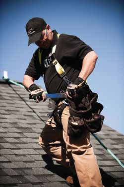 Heritage Roofing Servicing a Roof