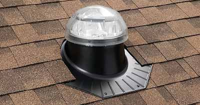 Skylight installed in a composition tiled roof